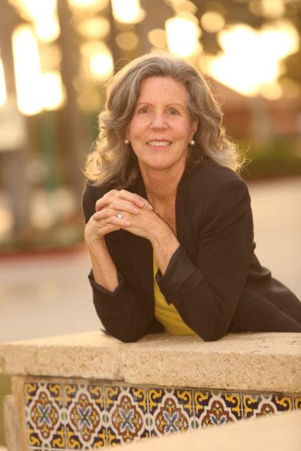 Anne Gannon posing outside