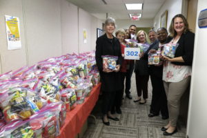 Anne and Employees with Food Donations