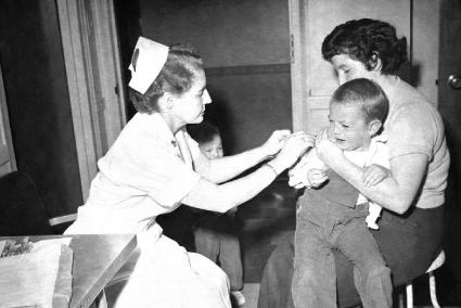 Nurse Giving Smallpox Vaccine to Child